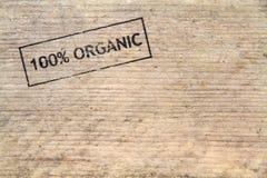 100% Natuurlijke gestempelde tekst op oude plank Stock Afbeeldingen