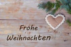 Natuurlijke Kerstmisgroeten in het Duits - Frohe Weihnachten Stock Foto