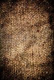 Natuurlijke linnentextuur voor de achtergrond De donkere textielbedelaars van Grunge Stock Foto's