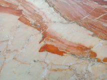 Natuurlijke marmeren oranje textuur als achtergrond stock afbeeldingen