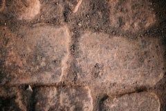 Natuurlijke oude steenachtergrond - stad in het zand Stock Foto's