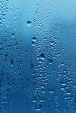 Natuurlijke waterdalingen op glas Stock Fotografie