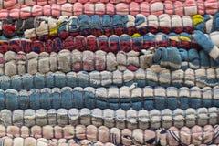 Natuurlijke wolstof met kleurrijke gemaakte hand - stock fotografie