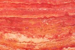 Natuursteen van rode kleur, travertijn van rode kleur met aders Royalty-vrije Stock Afbeeldingen