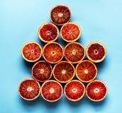 Natuurvoedingachtergrond van rode citrusvruchtensinaasappelen die wordt gemaakt Stock Afbeeldingen