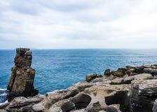 Nau dos Corvos crows, a rocky whim of the sea Royalty Free Stock Images