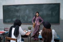 Nauczyciela nauczania uczeń Zdjęcie Stock
