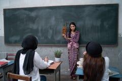 Nauczyciela nauczania uczeń Fotografia Stock