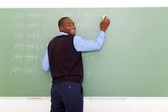 Nauczyciela wymazuje chalkboard obraz stock