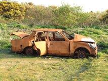 Naufragio abbandonato dell'automobile Fotografia Stock