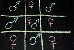Male female naughts and crosses Stock Photo
