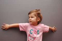Naughty. A naughty three year old girl in a pink shirt Royalty Free Stock Photo