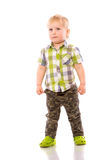Naughty blonde little boy in shorts and shirt Stock Images