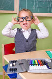 Naughty boy in classroom. Naughty little boy playing school Royalty Free Stock Photography