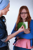 Naughty boy giving girl a marijuana joint. Naughty boy giving polite girl marijuana joint Royalty Free Stock Photo