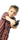 Naughty boy with a gun Royalty Free Stock Photo