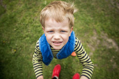 Naughty boy looking up. Close up Stock Image