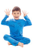Naughty boy in pajamas on white background Stock Image