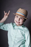 Naughty boy. Vertical portrait of a naughty boy in a hat, concept of misbehave Stock Photography