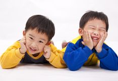 Naughty boys. Two naughty boys,asian brothers Royalty Free Stock Photo