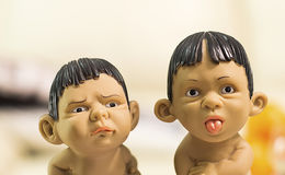 Naughty boys. Figurines facing and looking to the camera and making face expressions, showing tongue stock photos