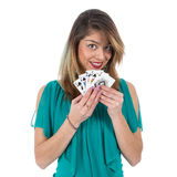 Naughty Brazilian woman shows winning royal flush poker cards. Isolated at white background Royalty Free Stock Photography
