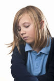 Naughty child. A sulking school girl with attitude Royalty Free Stock Image