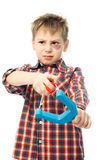 Naughty child. Naughty boy with a bruise under his eye holding a slingshot and looking at something Stock Photo