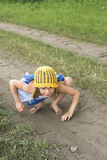 Naughty child. Naughty girlie playing on the earth road royalty free stock photo