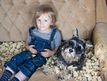 Naughty child and dog Royalty Free Stock Photos