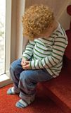 Naughty child in Time Out. (Acted) photo of a naughty little boy (3) in time out on the staircase, looking very guilty Royalty Free Stock Images