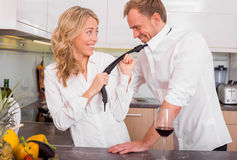 Naughty couple in kitchen Stock Photos
