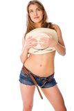 Naughty cowgirl. Young woman covers herself with her hat Stock Images
