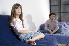 Naughty crying girl and sad father Stock Photo