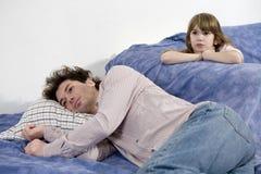 Naughty crying girl and sad father Stock Photos