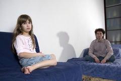 Naughty crying girl and sad father Royalty Free Stock Photography