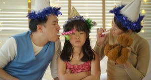 Naughty daughter ignoring father and mother in the party at home. stock video footage