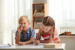 Naughty and diligent kids Stock Images