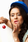 Naughty funky girl sucking lollipop Royalty Free Stock Image