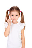 Naughty girl. Cute naughty little girl gesturing with her finger royalty free stock image