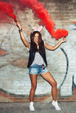 Naughty girl in pink rabbit ears with red smoke bombs Royalty Free Stock Image
