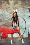 Naughty girl in pink rabbit ears with red smoke bombs Royalty Free Stock Photos