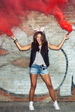 Naughty girl in pink rabbit ears with red smoke bombs Royalty Free Stock Images