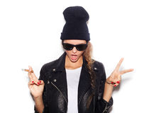 Naughty girl in sunglasses giving the Rock and Roll sign Stock Photo