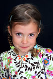 Naughty girl with tears in eyes Stock Photo