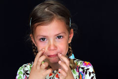 Naughty girl with tears in eyes Royalty Free Stock Images