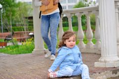 Naughty Girl 2 years old sitting on ground Royalty Free Stock Photo