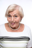 Naughty granny making faces Stock Images