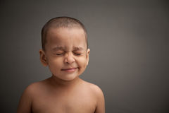 Naughty Indian Baby Amaze And Smile Stock Photo