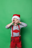 Naughty kid dressed like christmas elf Stock Photos